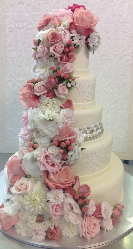 Five tier wedding cake with fresh flowers