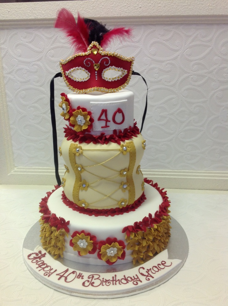 Red, white and gold birthday cake