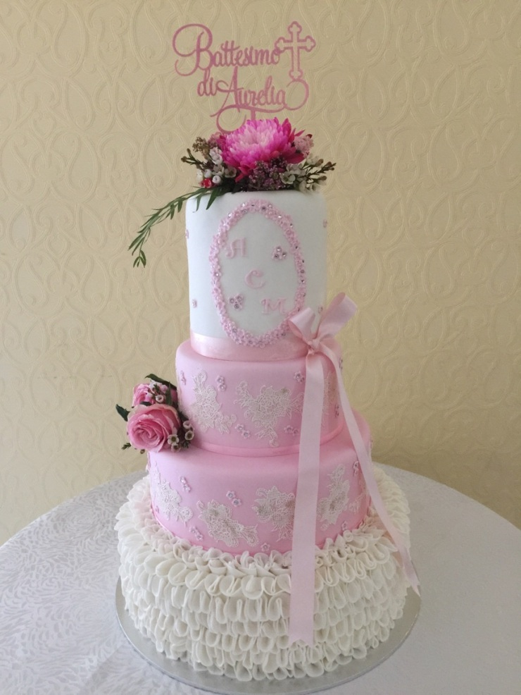 Pink and white four tier cake