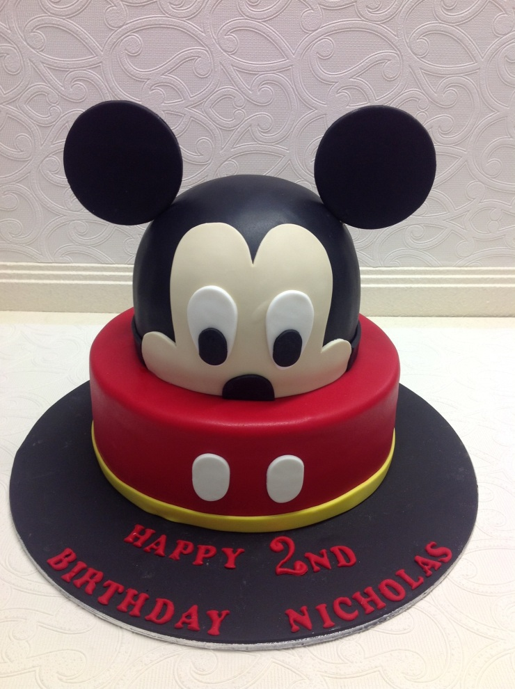 Disney character birthday cake