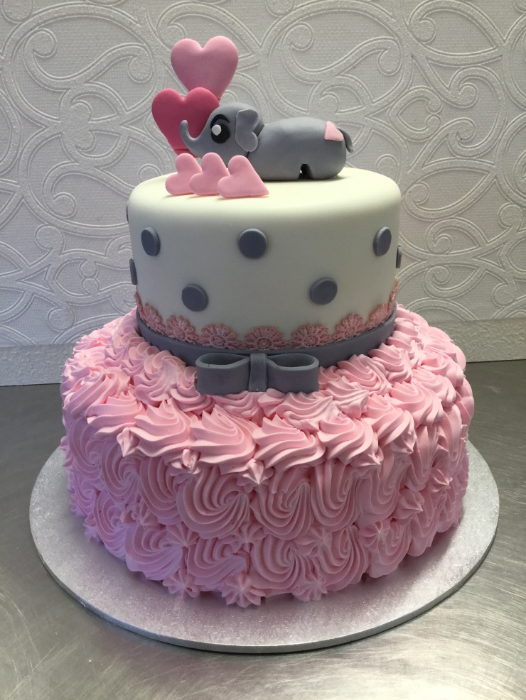 Pink and white elephant cake
