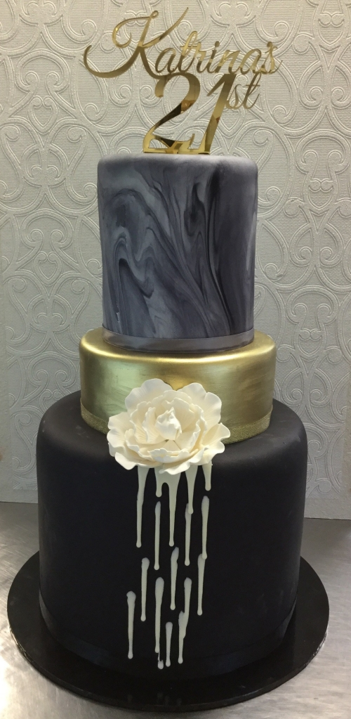 Black, gold and silver marble tier cake