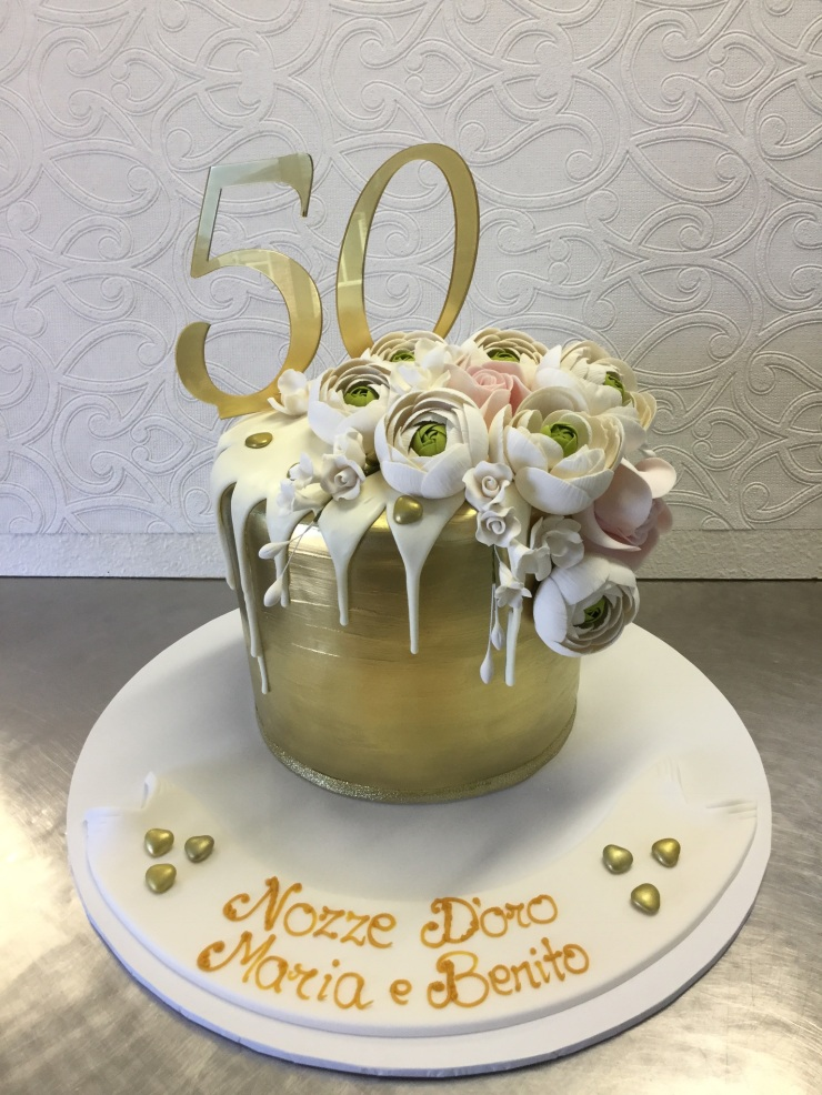 Gold and white anniversary drip cake
