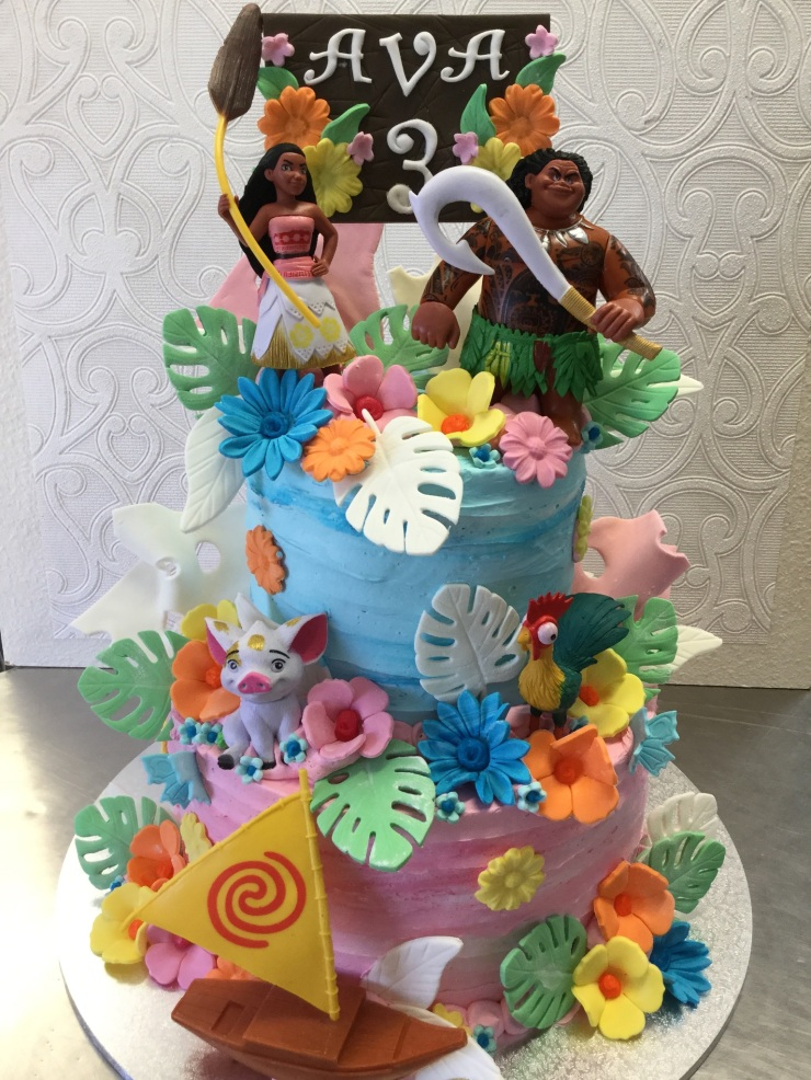 Zany colourful Moana and Maui birthday cake
