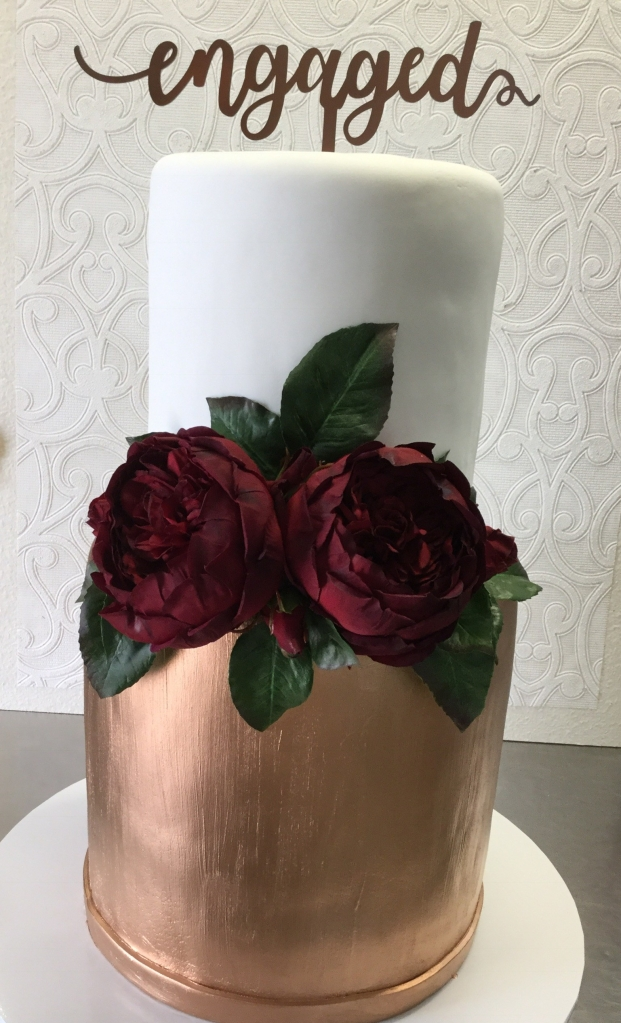 Rose gold and white cake with fresh peony roses